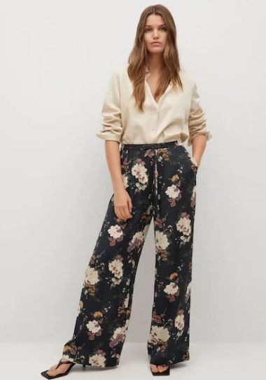 Pantalones de campana flores Mango