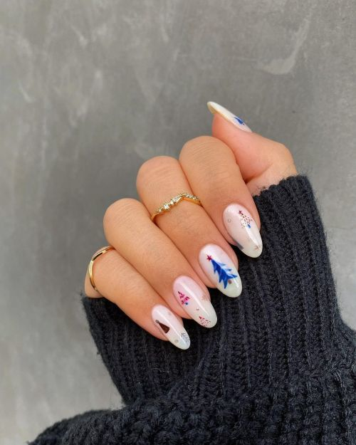 Uñas blancas con dibujo de abeto en azul
