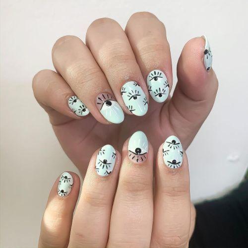 Uñas blancas cortas con ojitos