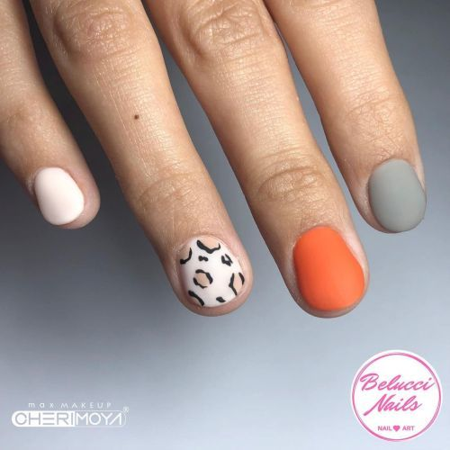 Uñas skittles naranja, gris y animal print