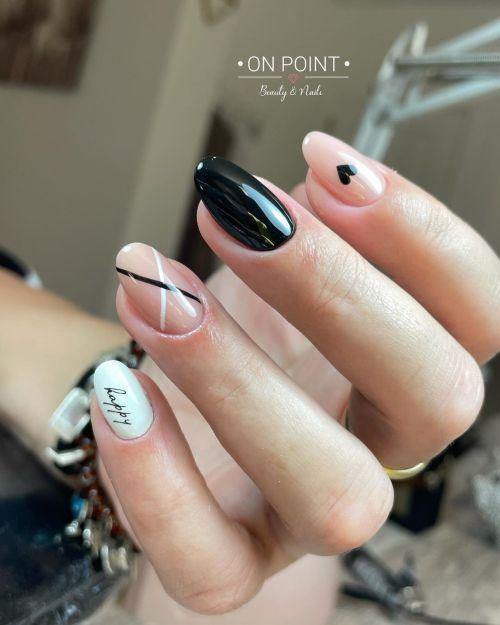 Uñas combinadas de negro, rosado y blanco con detalles múltiples