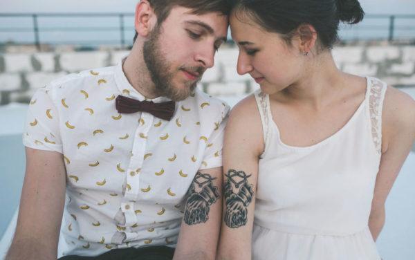 Tatuajes de familia grandes mismo tatuaje en el brazo