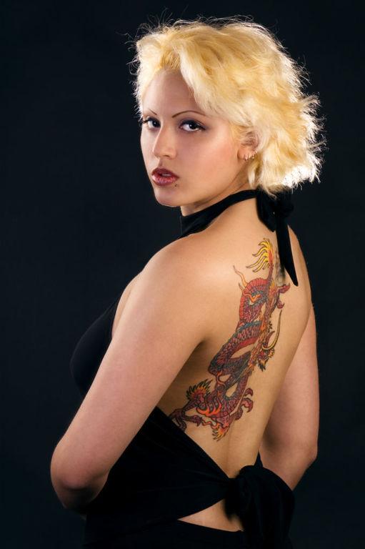 Tatuajes en las costillas grandes dragones